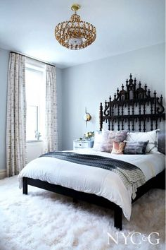 """A Carroll Gardens couple hired Manhattan-based interior designer Tamara Eaton to spice up their Brooklyn townhouse. The couple wanted the atmosphere to be """"sophisticated and refined, but still young and fun and casual,"""" Eaton says. Soon enough, a collection of sprightly feminine artwork, billowy floor-length drapes, edgy light fixtures, and sharp colors brought the space to life."""