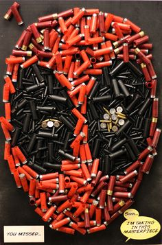 You Missed by Mike Oncley  Deadpool mask done with empty shotshell and cartridge casings.
