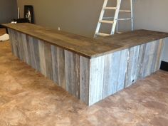 Shannon built our counter for Vapor Planet with unfinished oak cabinets ( all the drawers are facing inward) then he added reclaimed wood boards to them and a stained plywood counter top. I love it! www.facebook.com/vaporplanetcig