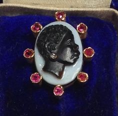 Here is a realistic, beautiful, antique cameo of a black lady that dates from about 1880. It comes in an original blue velvet fitted box
