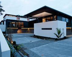 Chic Contemporary House Design with Large Yard: Exquisite Evening View Lucerne House Exterior Modern Landscape