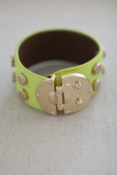 Giveaway Item!  Shop at TrendyBlendy.com and just add this baby to the cart for free!  http://www.trendyblendy.com/products/snap-to-it-studded-bracelet-in-lime