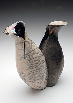 i like these vases because of the raku and the way the artist cut and made the neck in different ways