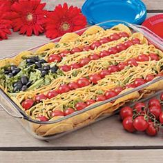 Layered Flag Taco Dip: lay blue chips on the bottom, next add a layer spread of refried beans and taco seasoned meat, add a layer of diced tomatos and cliantro (try a can of Rotel), top with white cheese, use black olives for stars and halved cherry tomatos for stripes!