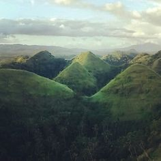 From the summit of green hills, Legazpi City