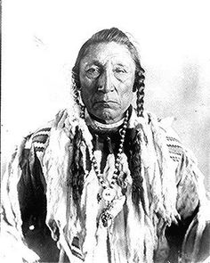Curley Bear (Car-io-scuse), a Blackfoot (Siksika) chief;  dressed in ermines.  Photographed by DeLancey Gill, 1903.  American Indian Select List number 95