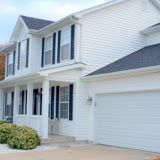Shingled roofing and vinyl siding by ARAC Alliance Restoration And Consulting.
