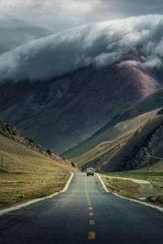 I cannot tell if the colors in this picture contains a filter of some sort, but if it does I really like it. I like the darkness that turn in to light as the road continues. Also the clouds that consume the mountains have the perfect shade of white.