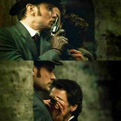 "Using Watson's chest as a spyglass-rest. ""Sherlock Holmes"" - Jude Law, Robert Downey Jr."