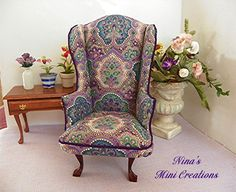 This is the 1:12 scale Wing back chair that I created entirely from scratch! The beautiful fabric was given to me by a lovely lady, who is a quilter. Nina Eary
