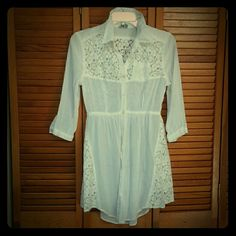 """Free People White Lace Button Up Dress/Top This beautiful Free People White Lace Button Up Dress can also be used as a top or a bathing suit cover!  I purchased it in a large to wear as a dress (I am 5'4""""). The lace is beautiful and delicate. Has a little breast pocket on the left side and a tie in the back so you can scrunch it tight or leave it flowy. Pre-loved but still in great condition! Free People Dresses"""