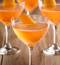 The Sideshow      1.5 oz Calvados Boulard VSOP     0.5 oz Galliano L'Autentico     0.25 oz Combier Liqueur d'Orange     0.5 oz Fresh Lemon Juice     2 dashes Angostura Bitters     3 Cardamom Pods  Garnish: Orange Twist
