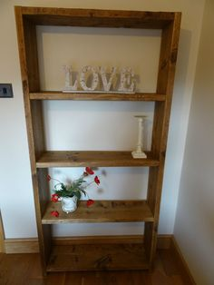Rustic solid wood reclaimed scaffold board shelf unit.