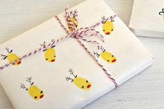 DIY #Rudolph finger printed wrapping paper. Such a cute, easy and thoughtful way to give a gift!