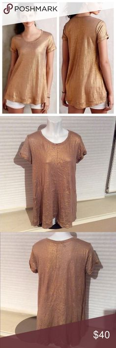 ANTHROPOLOGIE BORDEAUX Shimmered Linen Gold Top SM EUC. There is a small hole in the right shoulder, as pictured. 100% Linen. This item runs large, please see measurements *Measured Flat* Across Shoulders: 16in Sleeve Length: 6in Top to bottom hem(back): 29in Top to bottom (front): 24in Anthropologie Tops Tees - Short Sleeve