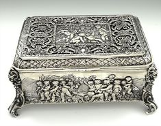 Large German 800 silver table box with chased cherubs and scenes