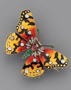 AN ANTIQUE ENAMEL AND GEM-SET BUTTERFLY BROOCH The emerald body, ruby thorax and diamond-set head with ruby eyes, to the yellow, red and black basse-taille enamel wings with old-cut diamond detail, mounted in silver and gold, circa 1880, 5.7 cm. wide, with French assay marks for gold, in blue velvet fitted case.