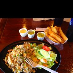 Arroz Chaufa, yucca fries, and spicy green sauce at Mami Nora's