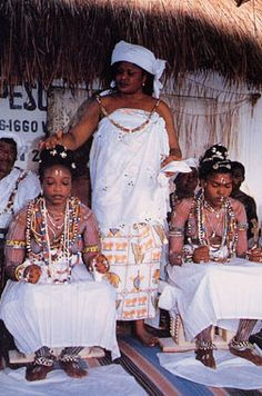 "These young women from Togo are being initiated into the mysteries of the Voodoo belief system as priestesses; they have been ""chosen"" and then spent time, as much as six months, in the sacred forest communing with the spirit world and learning the language, secrets, history, and healing of the cult."