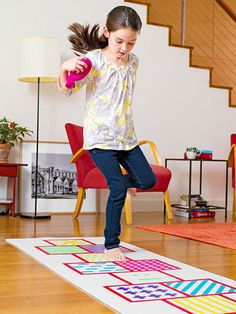 Stretch the life of an old yoga mat by turning it into an indoor version of hopscotch.
