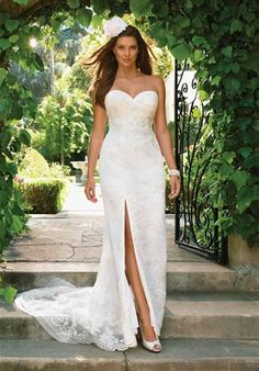 Casablanca   Gown features beaded lace appliques and zippered slit in skirt.    Silhouette: Sheath  Neckline: Sweetheart  Gown Length: Floor  Train Style: Attached  Train Length: Court  Fabric: Net, Satin  Embellishments: Beading, Lace  Color: White, Ivory, or Champagne  Size: 2 - 28  Price: $$