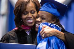 First Lady Michelle Obama hands a diploma to a graduating senior during the Martin Luther King, Jr. Academic Magnet High School for Health Sciences and Engineering at Historic Pearl High commencement ceremony, at the Howard C. Gentry Complex in Nashville, Tenn., May 18, 2013. (Official White House Photo by Chuck Kennedy)