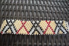 Inspired by a well-known British brand.    This beautiful bracelet is woven from exactly 248 Czech firepolished glass beads in beige, black, white and
