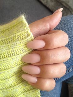 nude almond nails. Am feeling the almond trend. Not quite stiletto nail but safer maybe.