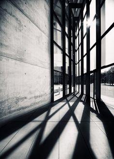 Black and white. Light casting through the windows.