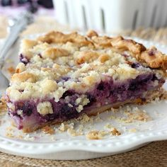 This Blueberry Sour Cream Pie is sweet, yet tart and so delicious. It's made with a creamy filling, a streusel topping, and is always a big hit!