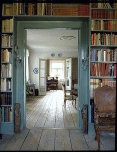 pretty blue bookshelves and blue trim