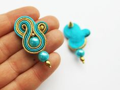Earrings made in soutache embroidery technique. The color of turquoise and gold.  Material: Glass pearl, gold-plated sticks, fire polish beads  Earrings length 4,3 cm (with earwire). Finished with felt  Impregnated.  If you have a question, write to me :) ------------------------------------------------------------  I invite you to watch my other works :)  https://www.etsy.com/shop/MrOsOutache?ref=pr_shop_more