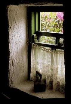 .sweet deep window.A glimpse of the garden beyond.Speaks of quietude and serenity.