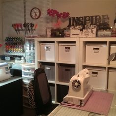 My Ikea Expedit workstation and shelving.  Thiis is my dedicated sewing and craft area. Black white and fushia color scheme.