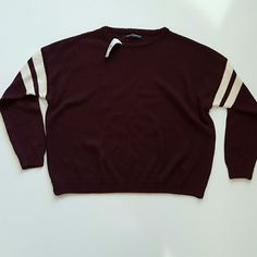 Brandy melville maroon veera sweater Super adorable and comfortable brandy melville maroon sweater that is veera style with cream colored stipes like a varsity jacket. Color on the tag says burgundy and one size fits most. Brandy Melville Sweaters Cardigans