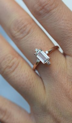 This Engagement ring features a White sapphire in emerald cut. The sapphire is natural, eye clean and sparkling. It is set in a setting flanked by 4 diamonds. This ring would make a perfect engagement ring, anniversary ring or promise ring. Emerald Cut Engagement, Morganite Engagement, Perfect Engagement Ring, Rose Gold Engagement Ring, Engagement Ring Settings, Vintage Engagement Rings, Halo Engagement, Engagement Rings Minimalist, Handmade Engagement Rings