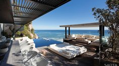 ZA Victoria 73: A sleek contemporary seaside villa set on a spur of land between Bantry Bay and Clifton this house epitomises elegance, luxury and...