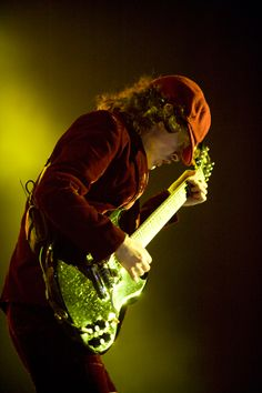 ANGUS YOUNG - AC/DC greatest band ever!  They rock the world, not just mine.