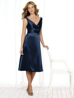 Tea-length Renaissance dress with wrap bodice and draped v-neckline. Bow at back. Sizes available 00-30W, and 00-30W extra length.  http://www.dessy.com/dresses/bridesmaid/6513/
