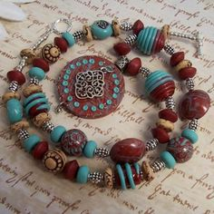 Polymer clay beads and pendant handmade by Carola G., and then fashioned into a stylish Southwestern necklace.