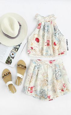 Halter Florals Top With Zipper Shorts   Suit Type : Shorts  Pattern Type : Floral  Color : White  Material : Polyester  Neckline : Halter  Sleeve Length : Sleeveless  Style : Cute  Decoration : Bow