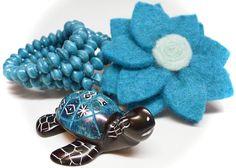 #Blue kisii #stone #turtle from #Kenya, #coiled #paper #bracelet from #Uganda & #felt #flower #brooch from #Nepal! #fairtrade #handmade #teal
