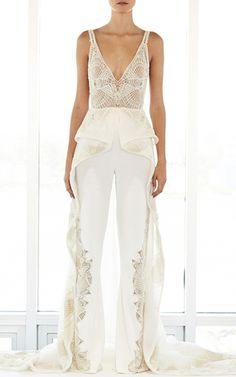 $11,950 YES PLEASE!! This **Jonathan Simkhai** Asymmetric Hem Skirt Jumpsuit features a plunge lace neckline, peplum waist, and attached embellished skirt with dramatic train.