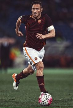 2592529bd Roma s forward from Italy Francesco Totti controls the ball during the  Italian Serie A football match Roma vs Bologna on April 2016 at Olympic  stadium in ...