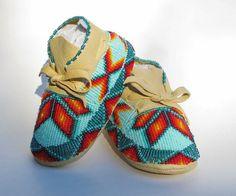 Native American Fully Beaded Baby Moccasins made of soft deer hide leather.