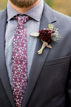 Mikkel Paige Photography photos from a Merrimon-Wynne House wedding in Raleigh. A deep purple fall boutonniere by Meristem Floral for a groomsman.