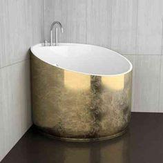 petite baignoire d'angle pour salle de bain de luxe