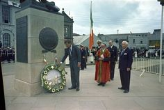 Day Two: President Kennedy lays a wreath at the John Barry Memorial at Crescent Quay in Wexford, Ireland. Also present are Mayor Thomas Burne, a naval aide, Minister of External Affairs Frank Aiken, and US Ambassador to Ireland Matthew McCloskey. Photograph by Robert Knudsen in the John F. Kennedy Presidential Library and Museum, Boston.