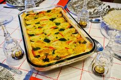 tarte de pastéis de bacalhau (a dish baked in another dish: codfish in dough baked in mashed potatoes and pastry)