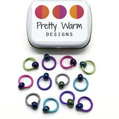 Set of twelve large multi coloured anodized aluminum rings with blue beads stitch markers with tin for knitting by Pretty Warm Designs